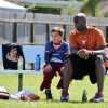 Ex-Longhorn Vince Young Walks at 2013 Graduation