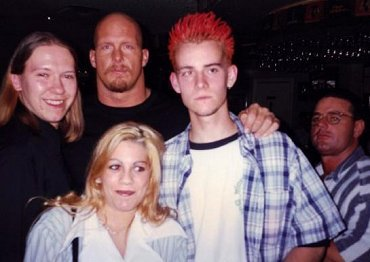 A young CM Punk poses with Stone Cold Steve Austin
