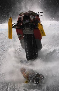 Caleb Moore hits the hard-packed snow as his snowmobile bucks recklessly. Photo courtesy Christian Murdock/The Gazette