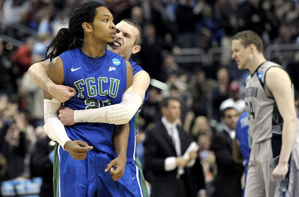 "BLUE-GREEN WITH ENVY: Florida Gulf Coasts, ahem, ""interesting"" school colors weren't the only thing worth talking about as they downed Georgetown in Philadelphia. Photo courtesy Michael Perez/AP"