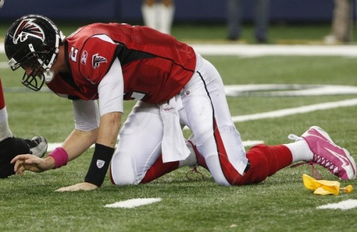 Falcons quarterback Ryan gets up after being sacked by the Cowboys during the second half of NFL football game in Arlington
