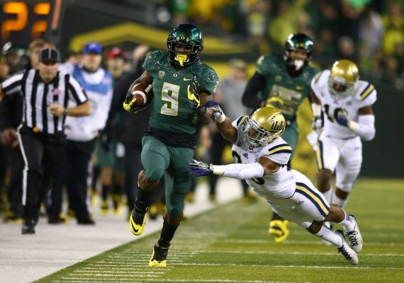 Byron Marshall and the Ducks were running past UCLA all game long. Photo by Getty Images